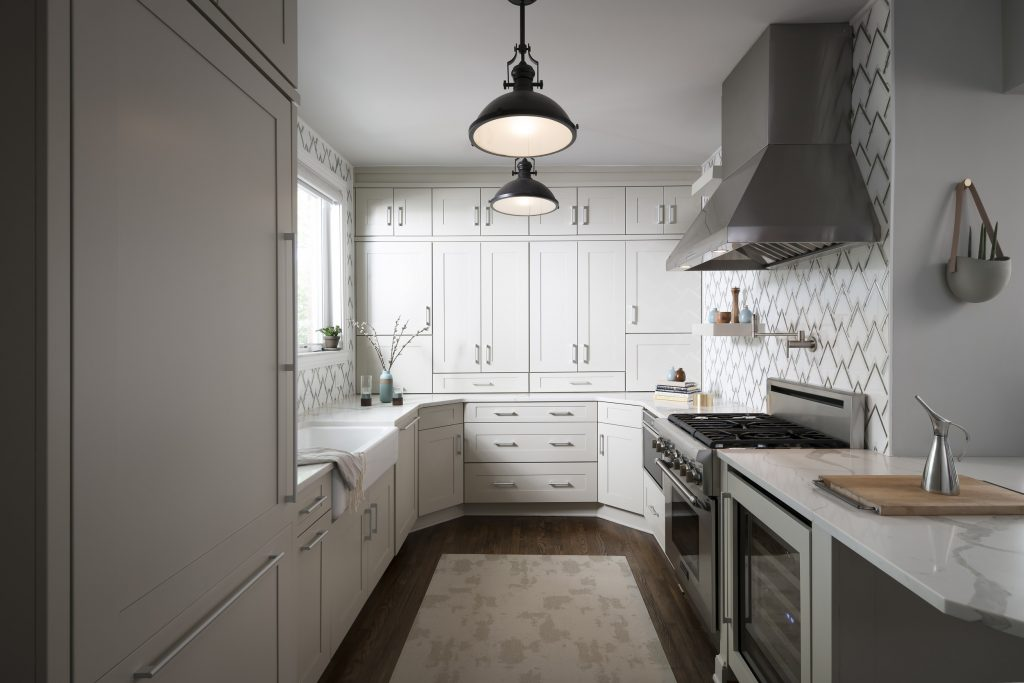 A modern kitchen with white custom cabinets by manufacturer, UltraCraft